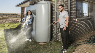 Nohad and Rebecca Nasas, with their dog Ozzie, at their new house in Oran Park.