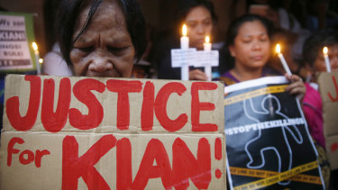 Protesters call for justice for slain teen KIan Loyd Delos Santos last year.