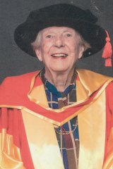 Maev O'Collins gets her honorary Australian Catholic University doctorate in 2019.