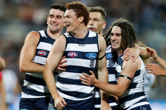 Mark O'Connor, Gary Rohan, Shaun Higgins and Gryan Miers of the Cats celebrate.