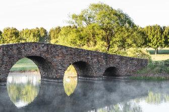 Linger on Mona Farm Homestead's Palladian-style bridge for platypus-spotting.