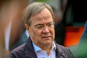 North Rhine-Westphalia's state premier and Christian Democratic Union (CDU) leader Armin Laschet visits flood-hit areas by the Erft River.