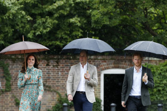 Prince William, the Duchess of Cambridge and Prince Harry at the memorial garden in Kensington Palace in 2017 paying tribute to  Princess Diana on the 20th anniversary of her death.