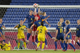 Sweden's goalkeeper Hedvig Lindahl clears away the ball from an Australian attack.