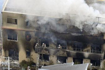 Firefighters respond to a building fire of Kyoto Animation's No. 1 studio in July.
