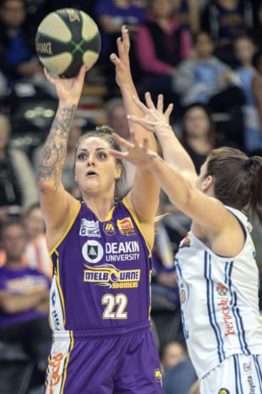Shooting star: Boomer Cayla George fires two of her game-high 27 points over Sydney's Belinda Snell.