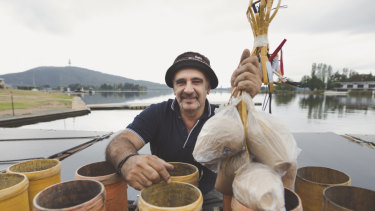 Pyrotechnician Fortunato Foti, pictured, packs mortars on Lake Burley Griffin on Thursday ahead of Saturday night's Skyfire.