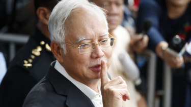 Former Malaysian prime minister Najib Razak gestures as he leaves the Malaysian Anti-Corruption Commission (MACC) Office in Putrajaya last Thursday.