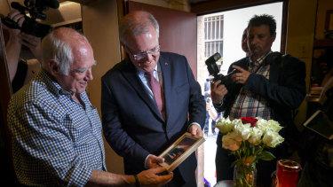 Prime Minister Scott Morrison visits Pellegrini's cafe in the wake of the Bourke Street attacks.