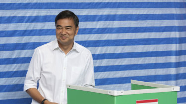 Democrat Party leader Abhisit Vejjajiva casts his vote at a polling station in Bangkok on Sunday. He has since quit after his party's poor showing.