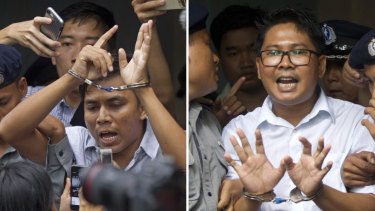 Reuters journalists Kyaw Soe Oo, left, and Wa Lone are escorted by police out of court on September 3.