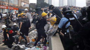 Police use pepper spray on demonstrators near the Legislative Council.