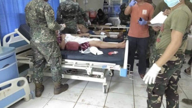 In this photo provided by WESMINCOM Armed Forces of the Philippines, bomb victims receive treatment in a hospital after two bombs exploded outside a Roman Catholic cathedral in Jolo.