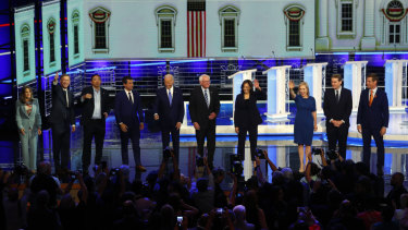 Democratic presidential candidates wave as they enter the stage for the second night of the Democratic primary debate in Miami.