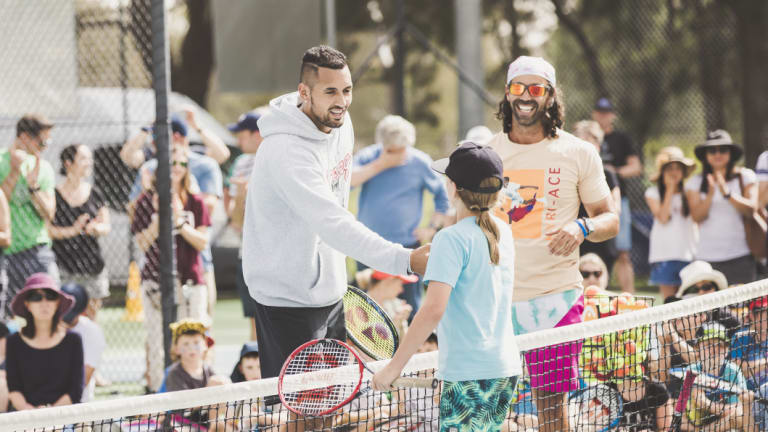 Nick Kyrgios raised more than $5000 for his foundation at a Kaleen tennis day on Saturday.