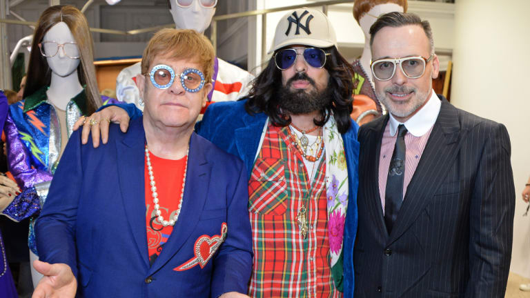"Michele with Elton John and John's partner David Furnish at a Gucci launch in London. ""He's just very down-to-earth,"" John says of the designer."