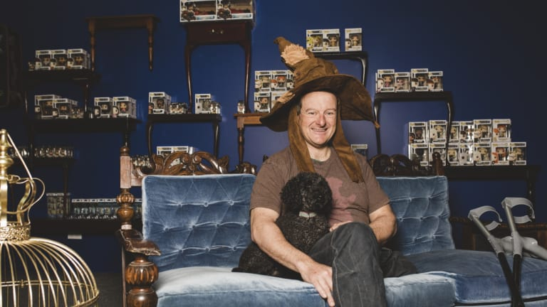 Former paralympian Michael Milton (with puppy Sparkles) and his family are behind new store Quizzic Alley on Pirie Street.