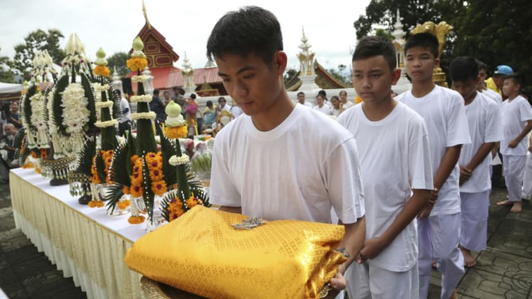 Soccer coach Ekaphol 'Ake' Chantawong, front, and members of the soccer team rescued from a flooded cave attend a Buddhist ceremony as they prepare to be ordained as Buddhist monks and novices in Mae Sai on Tuesday.