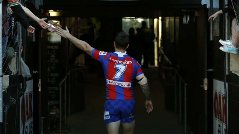 Satisfaction: Mitchell Pearce heads to the sheds after steering the Knights to victory.