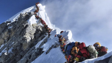 Climbers line up in the attempt to reach the peak of Mount Everest.