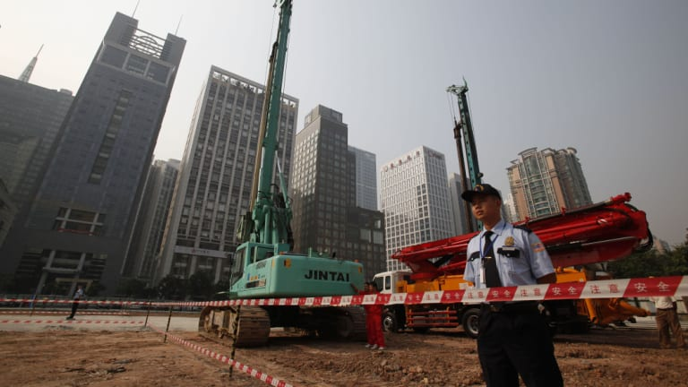Security workers guard at construction site of the US Consulate compound in Guangzhou in southern China's Guangdong province.