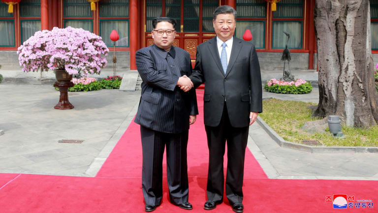 North Korean leader Kim Jong-un with Chinese President Xi Jinping in Beijing.