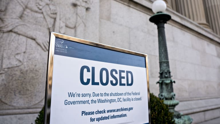 A sign announcing the closure of the National Archives due to a partial government shutdown.
