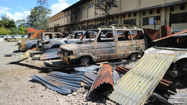 Burnt out vehicles in a car park after Monday's violent protest in Wamena, Papua province, Indonesia.