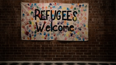 A Refugees Welcome banner hangs at the International Rescue Committee.
