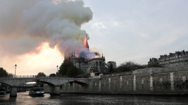 Notre-Dame burns by the river Seine.