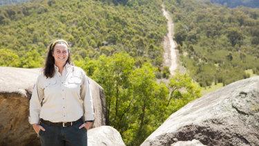Tidbinbilla's senior wildlife officer Jenny Pierson on part of the rock-wallaby's future, predator-proof home.