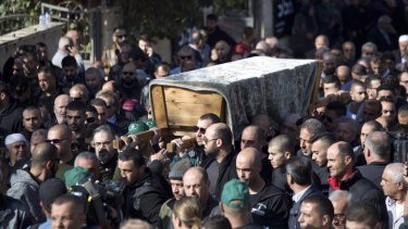 Relatives and friends carry the coffin of Aiia Maasarwe through the city of Baqa El Gharbiye, Israel.