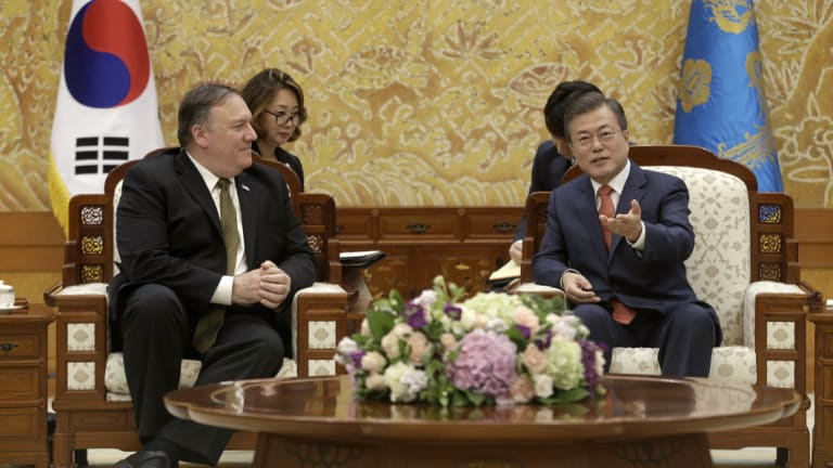 South Korean President Moon Jae-in, right, talks with US Secretary of State Mike Pompeo at the presidential Blue House in Seoul, South Korea, on Sunday.