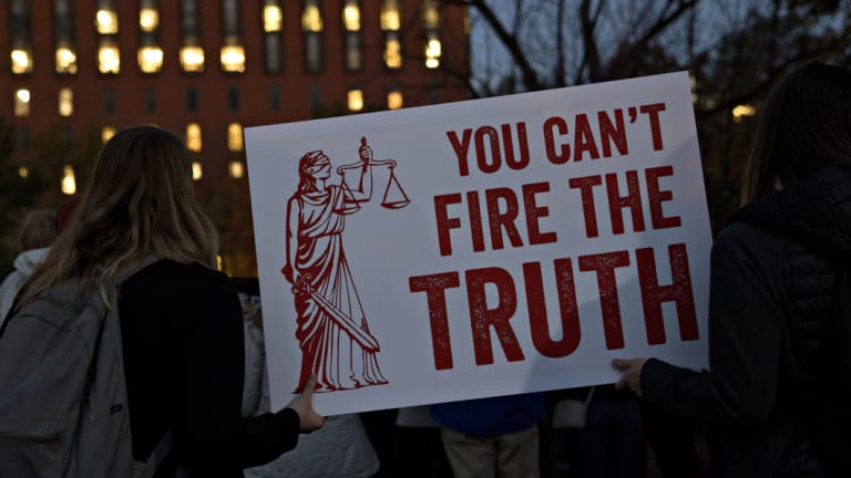 """Demonstrators, calling for the recusal of acting Attorney General Matthew Whitaker in overseeing Special Counsel Robert Mueller, holds a """"You Can't Fire The Truth"""" sign outside the White House in Washington, DC."""
