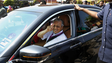 Former Malaysian strongman Mahathir Mohamad shows his finger after voting on Wednesday.