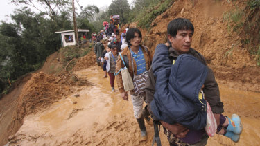 Residents and relatives of miners in Itogon, in the northern Philippines, evacuate following landslides triggered by Typhoon Mangkhut.