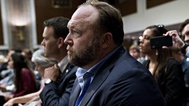 Alex Jones listens during a Senate Intelligence Committee hearing in Washington, DC.