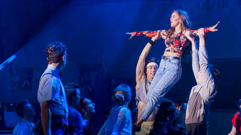 <p>Pippin Carroll, left asSchlomo and Maddy Betts (aloft) as Carmen in <i>Fame the Musical</i>.</p>