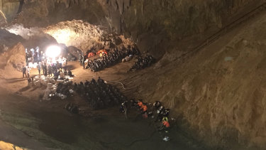 Emergency rescue teams search for a young soccer team and their coach missing in a large cave complex in Thailand.
