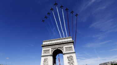 French war planes fly over the Arc de Triomphe in Paris on Bastille Day 2017. Trump is said to have taken inspiration from the event for a new July 4 format.