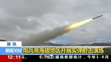 A rocket is launched during a live-fire drill by the Chinese army in China's Tibet Autonomous Region that borders India.