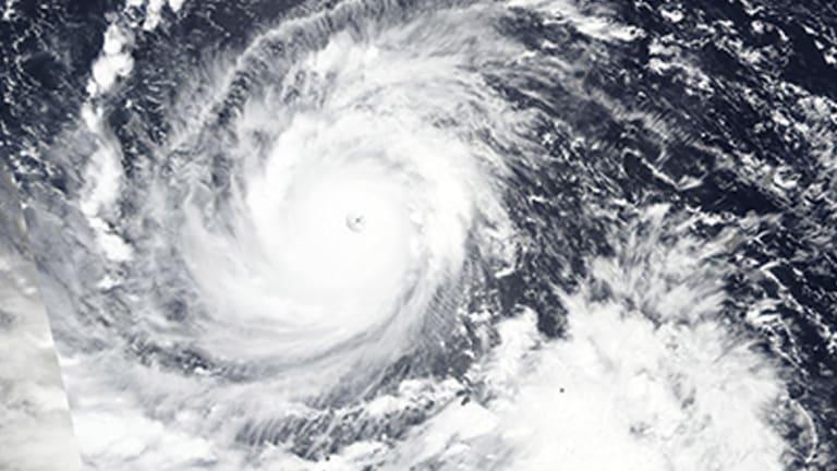 Typhoon Mangkhut churns west towards the Philippines.