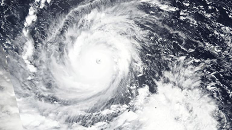 Typhoon Mangkhut churns west towards the Philippines.