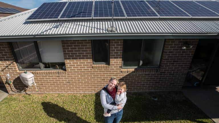 Gemma Cook, with daughter Mia, says the Andrews government's solar pitch is enticing.
