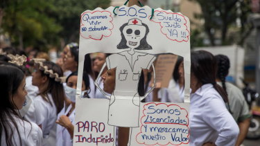 Public hospital workers have been protesting in Caracas for a month to demand better wages.
