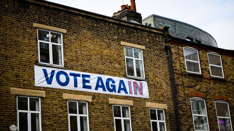 "A banner reading ""Vote Again"" using branding from the Britain Stronger in Europe campaign hangs on an architect's office in London on Friday."