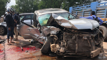 Cambodian Prince Norodom Ranariddh's mangled car sits on the side of a road after a collision with another vehicle outside Sihanoukville, Cambodia, on Sunday.