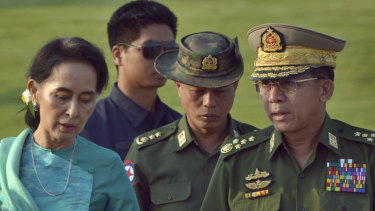 Military officers said that leader Aung San Suu Kyi, left, ordered security forces to launch the offensive against the Arakan Army.