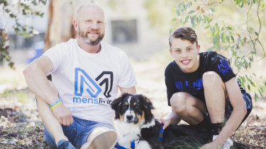 "Peter ""Cookie"" Davis of Menslink with Lachlan Kelly Hammond, 16, and his soon-to-be assistance dog Koda."
