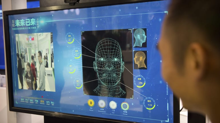 A facial recognition display by Chinese tech firm Ping'an Technology at the Global Mobile Internet Conference in Beijing.